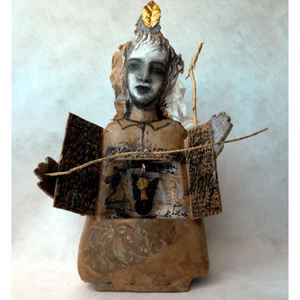 livre d'artiste ouvert dans une poupée de papier